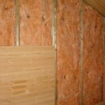 Insulation and Pine matchboard cladding